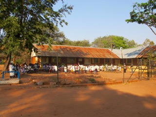 The mission school at Camundambala. White lab coats are the recognised uniform.